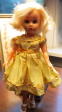 Doll in yellow dress